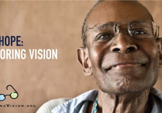 Restoring Vision logo on image of Man wearing reading glasses